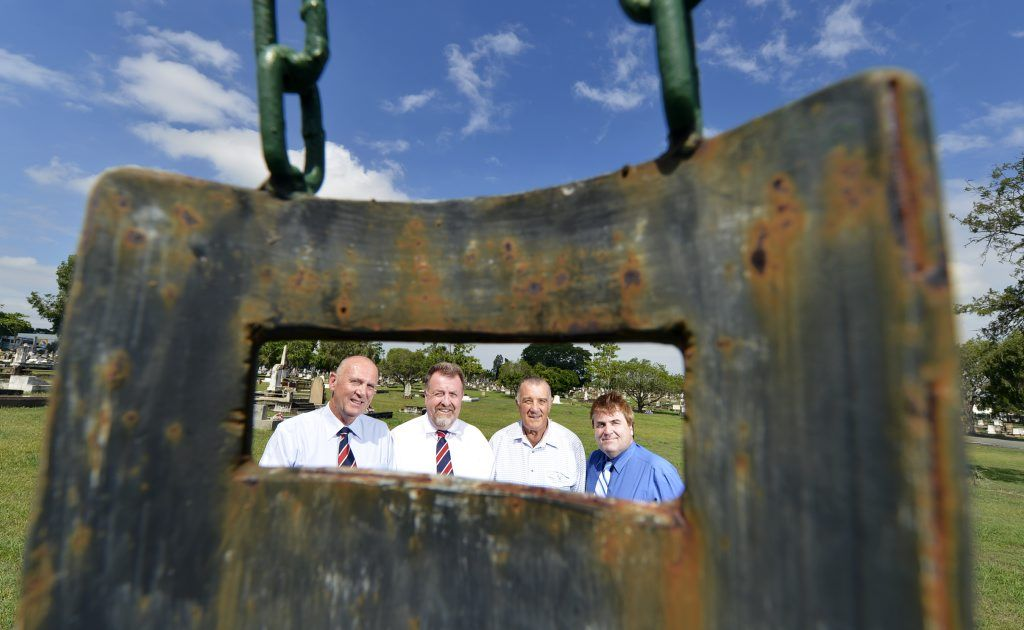 Councillors Bruce Casos, Paul Tully and David Pahlke with John Harris (centre right) at the Dan Kelly memorial in Ipswich General Cemetery. John Harris has unearthed new evidence that may verify Dan Kelly's existence in the Ipswich area in the 1940s.