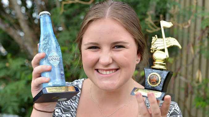 Stephanie Ward Wrigley with her awards.