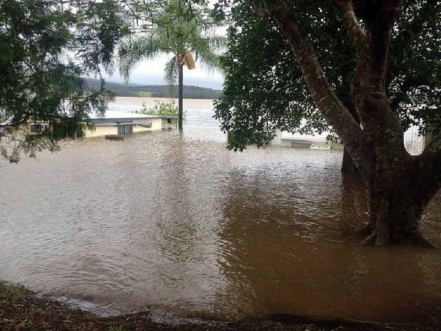 RECORD BREAKING: Flood waters inundate cabins at Lake Moogerah Caravan Park last Monday as the dam exceeded its capacity.