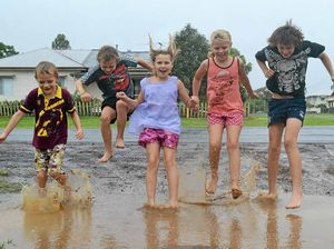 Dalby kids (from left) Thomas McGee, Clayton McGee, Dimity McGee, Zoe Babington and Trent McGee play in a puddle.