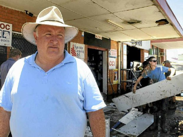RECOVERY EFFORT: Lockyer Valley mayor Steve Jones helps out with the clean up in Laidley on Tuesday.