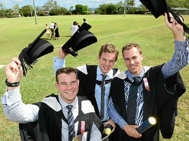 NEW RECRUITS: Graduating vet science students Nick Pretorius, Fabian Trefny and Ashley Vermeulen celebrate after finishing at the University of Queensland's Gatton campus last year.