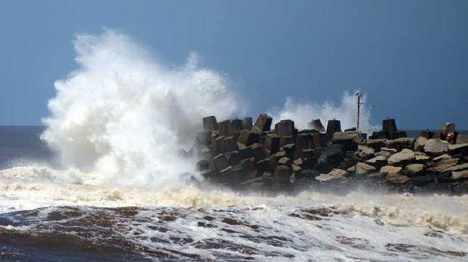 Waves slamming into tip of the south wall at Ballina. Photo: Patrick Gorbunovs