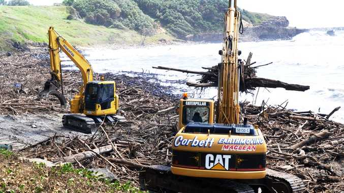 Heavy machinery swings into action removing debris from Yamba's beaches at the weekend.