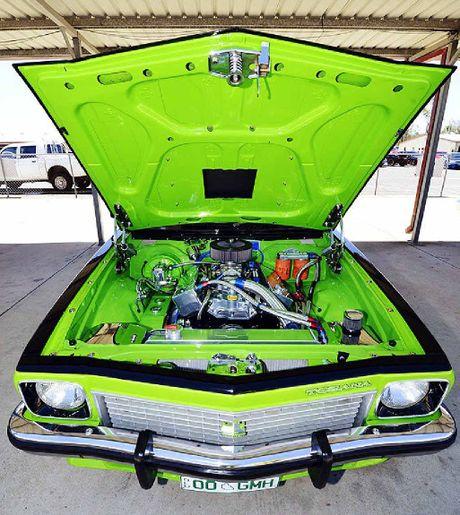 Under the bonnet of a lime green 1975 Holden Torana.