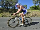 Ron Morgan in action on his bike during a triathlon.