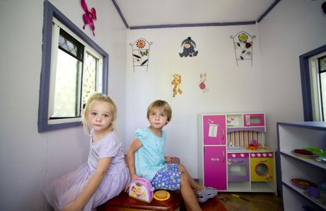 Jasmin Manteit and Amy Cox feel right at home in their beach-house style cubbyhouse.