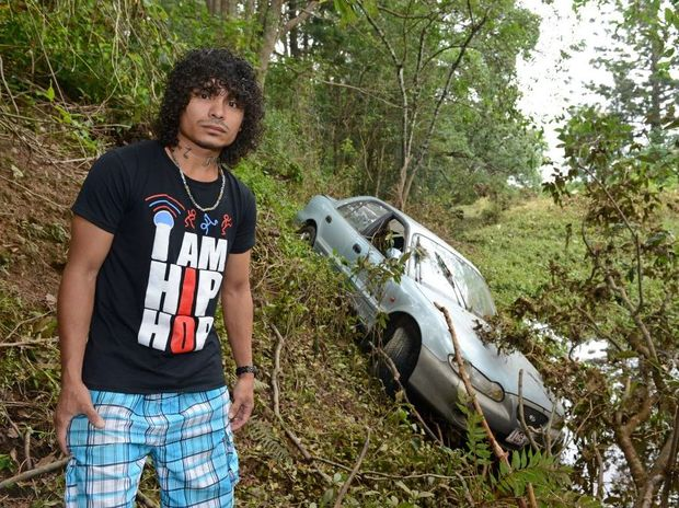 Armando Laarhoven with his car that was washed into the river. Photo: John Gass / Daily News