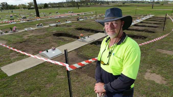 Grounds supervisor of Warrill Park Cemetery, Rick Nice, at some of the graves that sunk during the 2013 January flood.