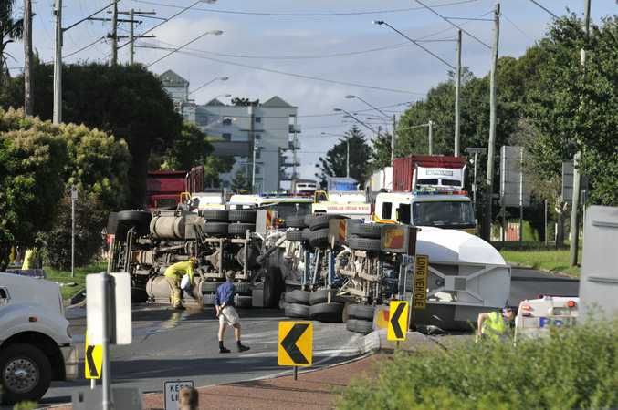 Emergency services at a truck rollover on the James St section of Warrego Hwy at the top of the range, Monday, February 04, 2013. Photo Kevin Farmer / The Chronicle