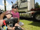 Residents living on the Cohoe Street, near the corner of James Street talk about their concerns after another truck rolled on that corner, spilling its load and blocking the intersection for hours overnight. Crown St resident Phil McCann with his one-year-old son Noah McCann. Photo: Bev Lacey / The Chronicle