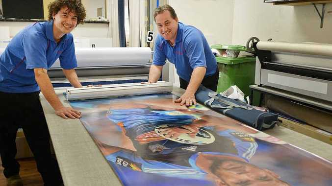 Luke Brook and Justin Brown from Sign-A-Rama produce Gold Coast Titian signs in the Gympie workshop.