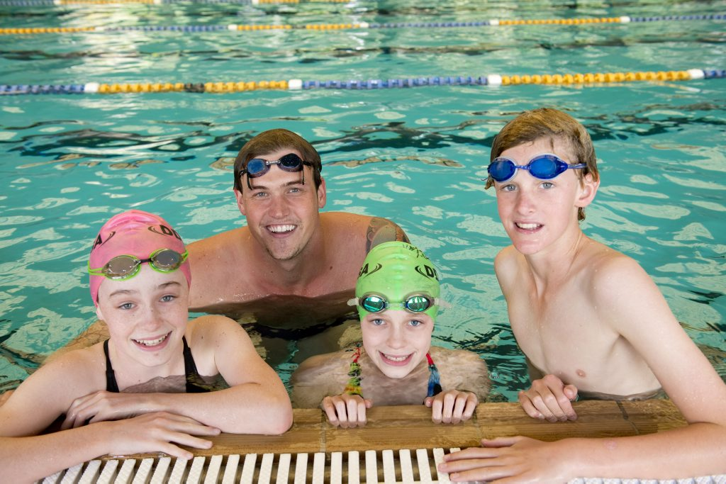 Junior Excellence swimming clinic ( from left ) Kodi Koina, Olympian Kenrick Monk, Kasey Koina and Eric Rattray. Photo Nev Madsen / The Chronicle
