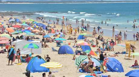 Australians rush to the beaches over the holiday break as the heatwave hits hard.