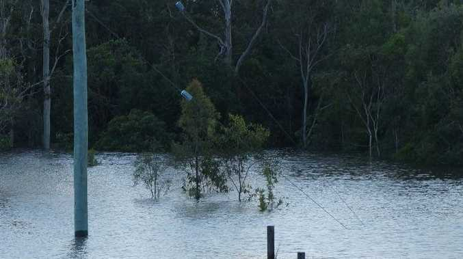 Power lines fell into floodwaters at Bidwill Rd at the start of the year.