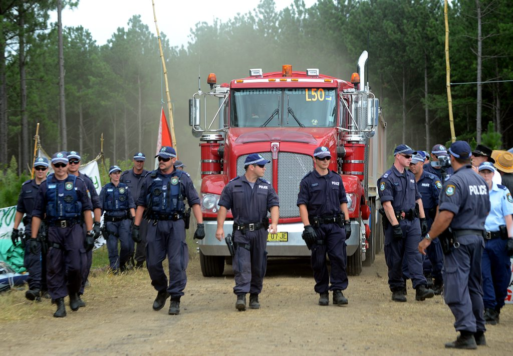 Police escort a truck from The Doubtful Creek CSG drilling site.