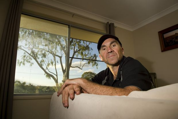 Hume St resident Peter Trezise has raised his concerns about towering gum trees on his footpath.
