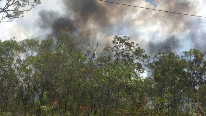 Firefighters are battling a bushfire behind a Noosaville school.