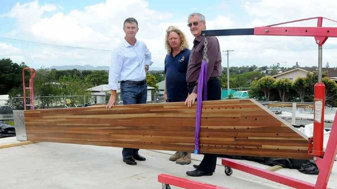 Housing and Public Works Minister Tim Mander checks on the progress of the Gympie Neighbourhood Centre with Site foreman Cameron Hetherington and Mayor Ron Dyne.