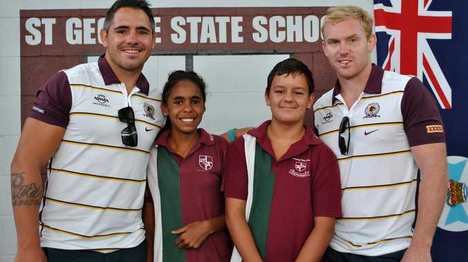 ANTI-BULLYING BRONCOS: Brisbane Broncos players Corey Parker (left) and Peter Wallace pose for a photo with St George State School captains Raylene Smith and Lachlan Colley after delivering an anti-bullying message on Wednesday.