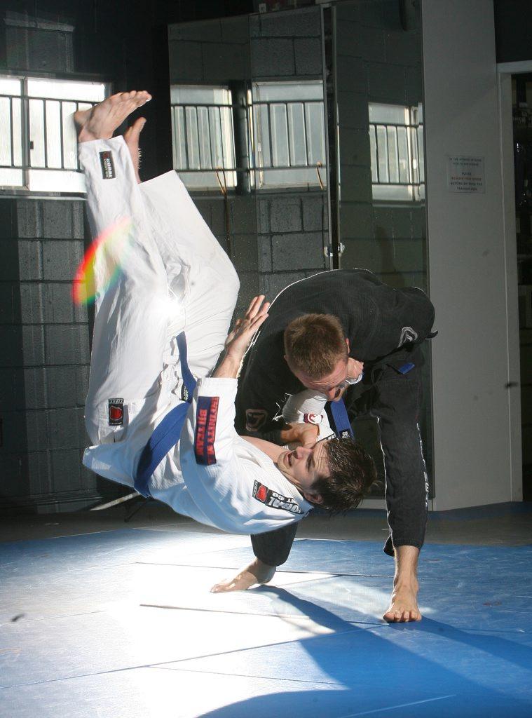 Two competitors competing in the Australian Brazilian Jiu - Jitsu championships in Darwin