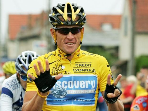 Lance Armstrong of the USA riding for the Discovery Channel team holds up 7 fingers which represents him winning a seventh consecutive Tour de France during Stage 21 of the Tour de France between Montereau and The Champs Elysees on July 24, 2005 in Paris, France.