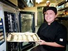 Maryborough RSL chef Sam Harvey pops a tray of pastries into one of the electric ovens.