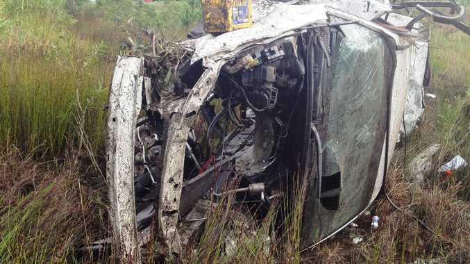 The crashed car on the Bruce Highway at Glasshouse Mountains.