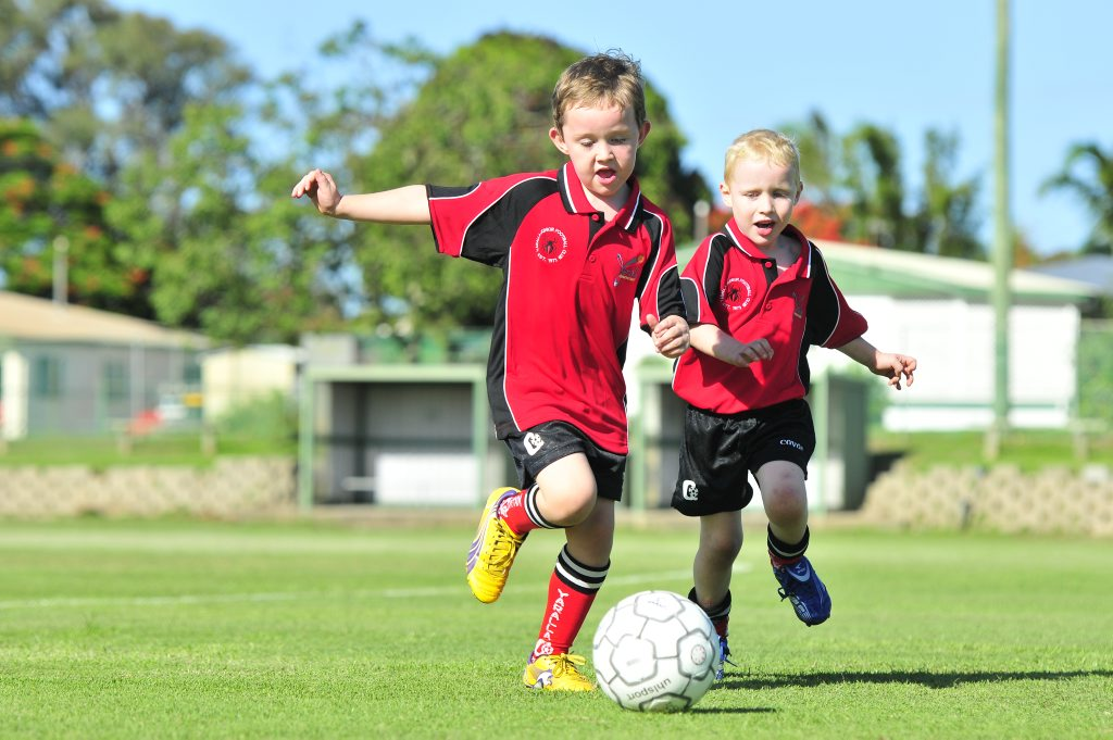 Yaralla Soccer Club is in it's 40th year this season. Alec Douglas, 6, and Connor Johnston, 5. Photo Tom Huntley / The Observer
