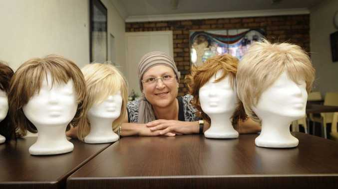 Cancer patient Kim Thompson's stay at the Olive McMahon Lodge receives a burst of fun as she models the Wig and Turban Library collection.