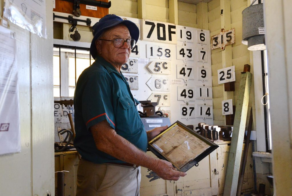 HISTORY LOST: Bundaberg Railway Museum co-ordinator Graham Hibbard and his colleagues are working hard to clean up and save historical documents after the flood. Photo: Scottie Simmonds / NewsMail