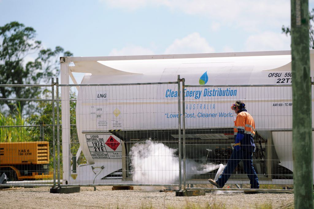 An APA employee watches as cold vapour is released as liquified gas is converted so it can be injected into the network.