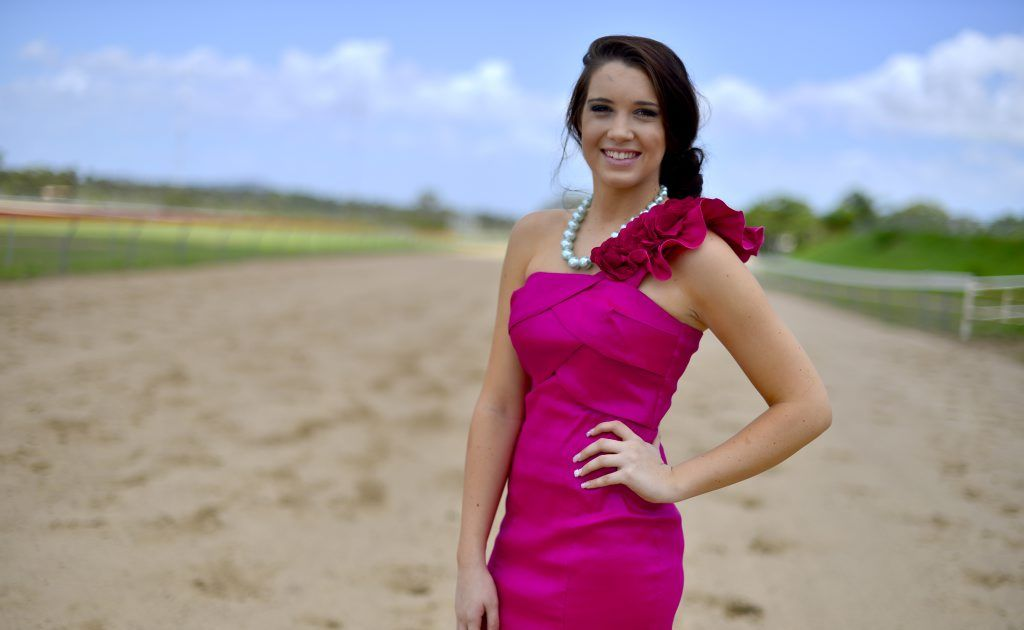 Celina Solis, 18 frocks up for the up coming Ladies Race Day at Ferguson Park, Gladstone. New, without tags, fuscia floral one shoulder race day dress $35.