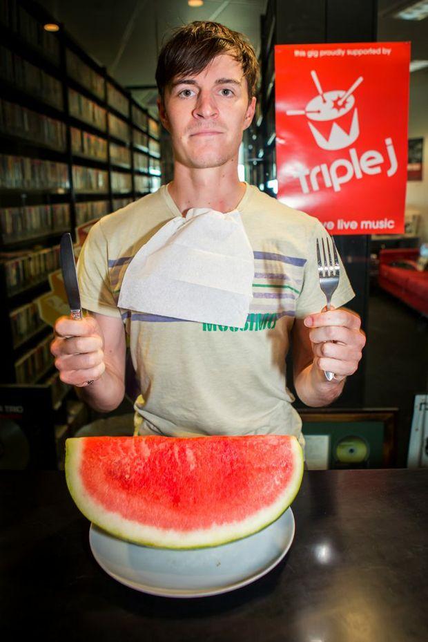 MUSICAL MELONS: Triple J radio host Alex Dyson prepares for the Chinchilla Melon Festival.