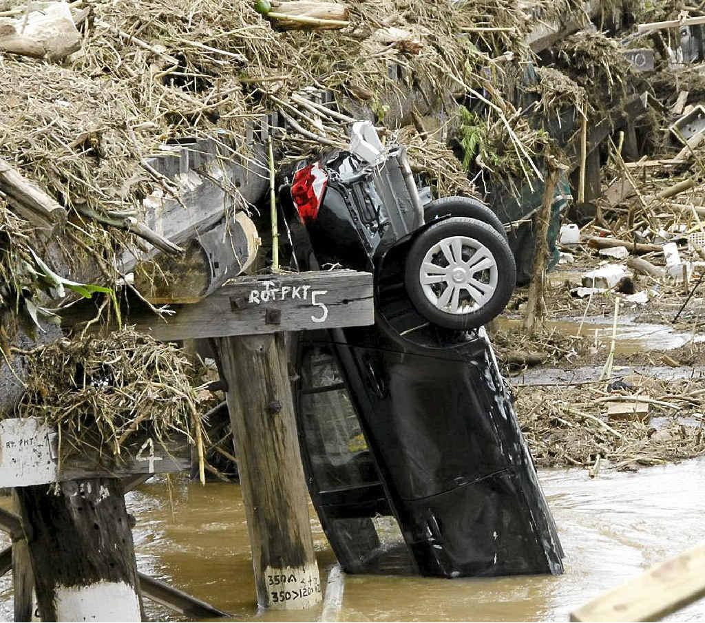 STARK MEMORIES: Cars piled against the bridge in the wake of Grantham's 2011 disaster.