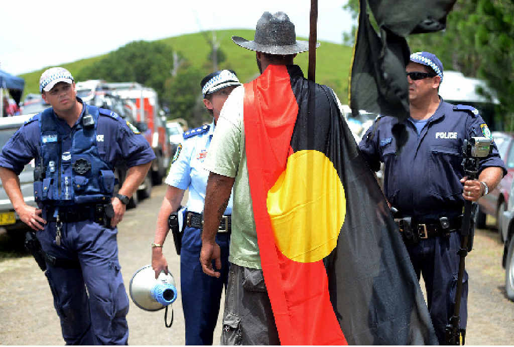 Richmond LAC duty officer, Inspector Nicole Bruce, confronts a protester yesterday at the Doubtful Creek CSG site near Kyogle in northern NSW. A massive police operation broke the 300-plus community blockade allowing CSG company, Metgasco, to get it drilling equipment on-site.