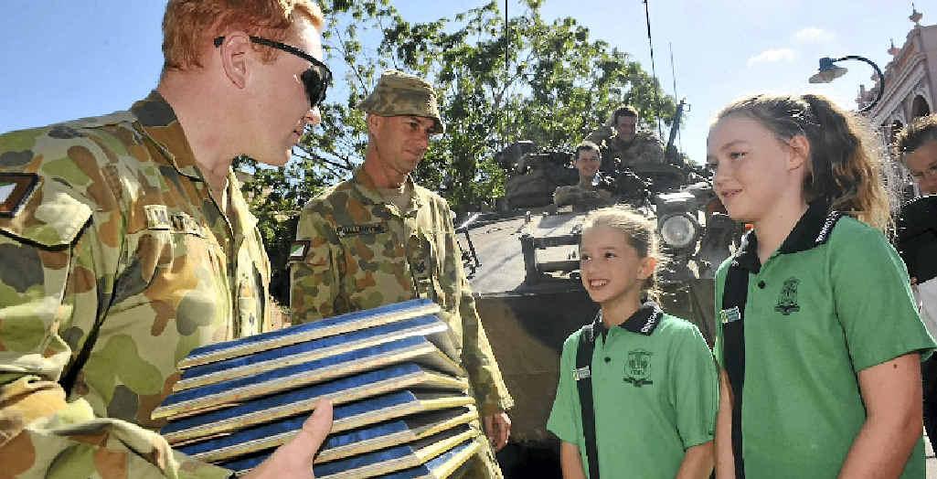 Bundaberg East State School's Maddelyn Batt and Ellie Anderson with Capt Adam Murgatroyd.