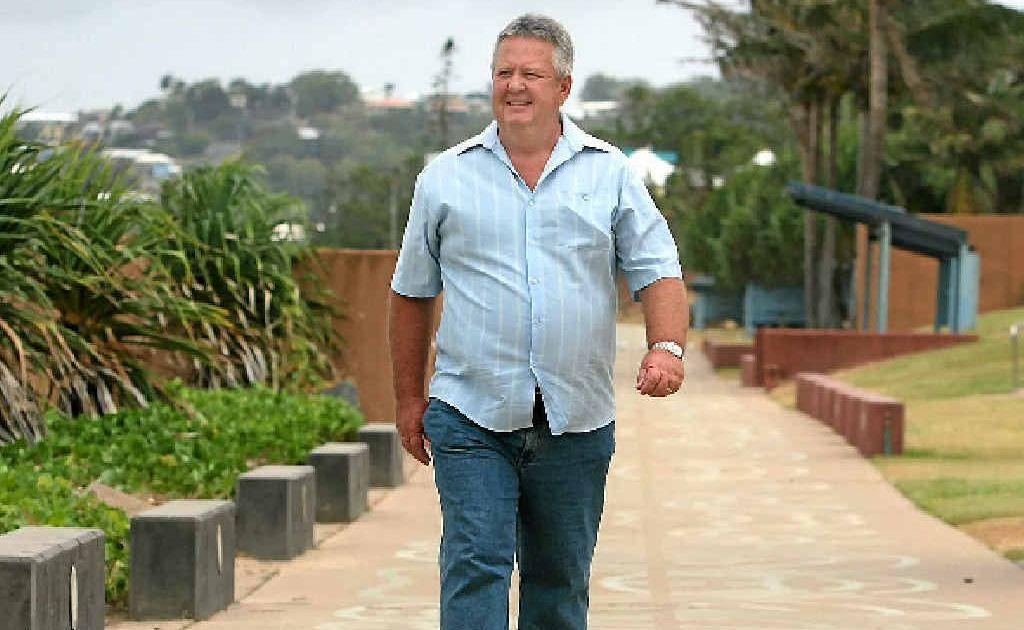Former Rockhampton mayor Brad Carter strolls along the beachfront at Yeppoon.