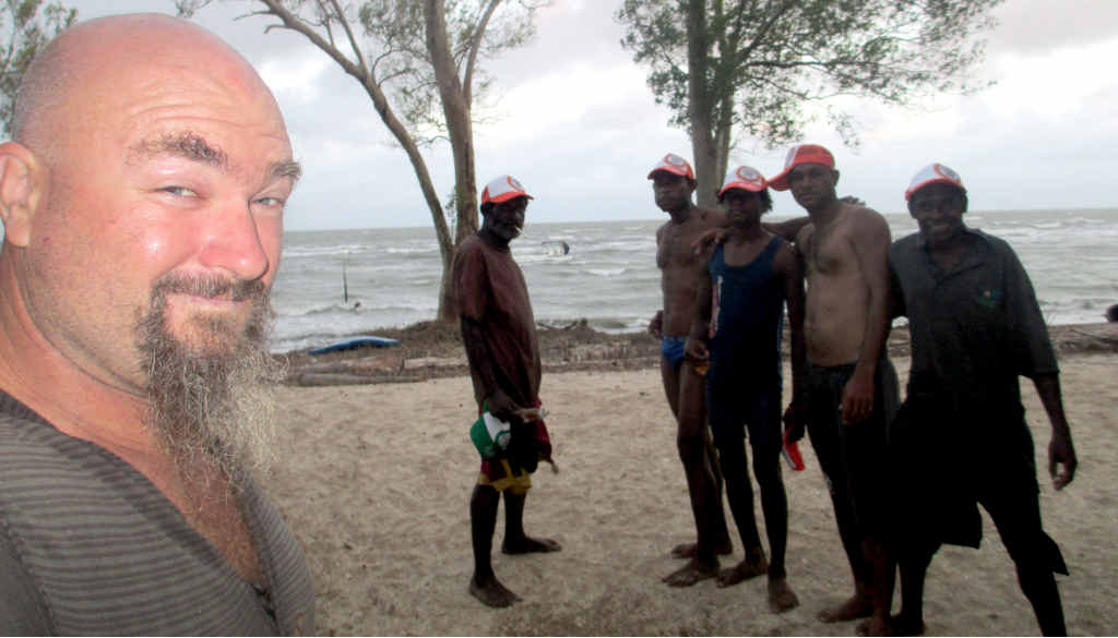 Craig Hand with some friendly PNG villagers prior to his run-in with pirates.