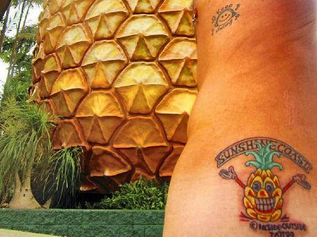 DEDICATED FAN: Dan Munro sporting his tattoo in front of the Big Pineapple.