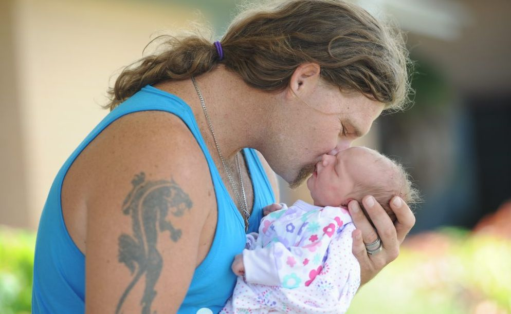 HOPE comes in different forms. For the Melanie Hansen and Steven Nunan Hope came at the end of a terrifying dash from Maryborough to Hervey Bay. Steven Nunan kisses his bay girl, Hope who was came into the world at a roundabout. Photo: Robyne Cuerel / Fraser Coast Chronicle