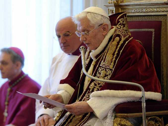 Pope Benedict XVI reads a document in Latin where he announces his resignation, during a meeting of Vatican cardinals, at the Vatican.