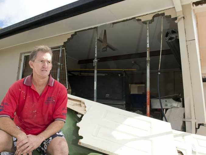 Paul Elbourne surveys the damage to his Luck St home garage.