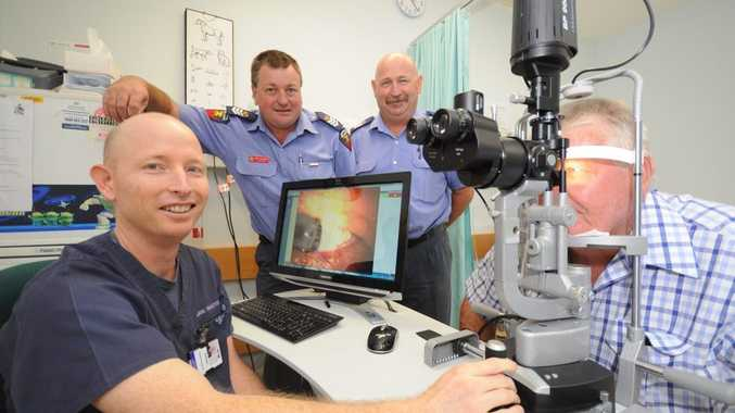 Checking out the Toowoomba Hospital slit lamp is (from left) nurse practitioner Andrew See, firefighters Darryl Williamson and Monty Clelland and John Wensley.