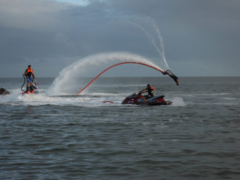A flyboarder at Torquay beach performs during a visit by Channel Seven's Sunrise.