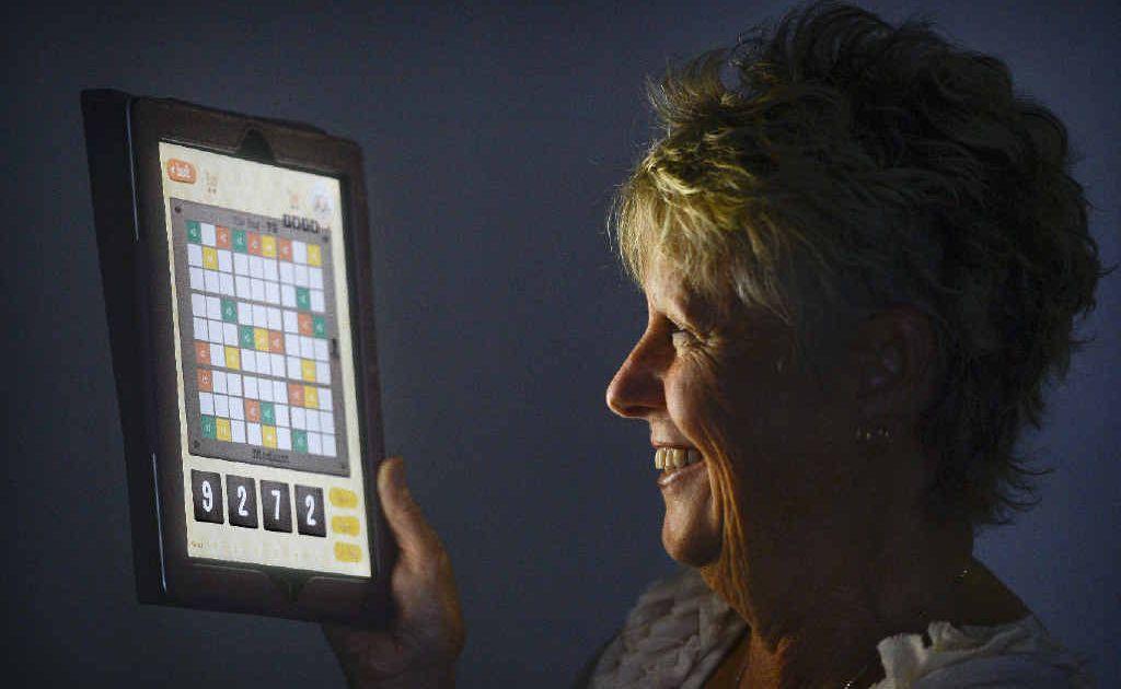 Sue Kearney with her newly developed iPad app Sudoku Flick.