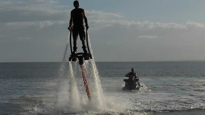 Sunrise weatherman Grant Denyer tries out flyboarding at Torquay beach.