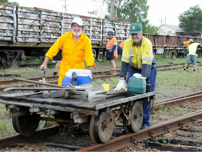 Rail guards Collin Waters and Tim Knowles with fellow MVHR volunteers prepare the track for sleeper replacement.