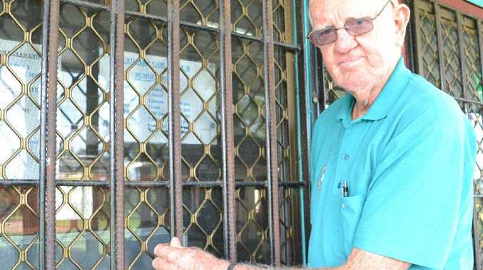 Coraki Golf Club treasurer Ray Hunt shows the double bars on the windows after numerous break-ins at the club.