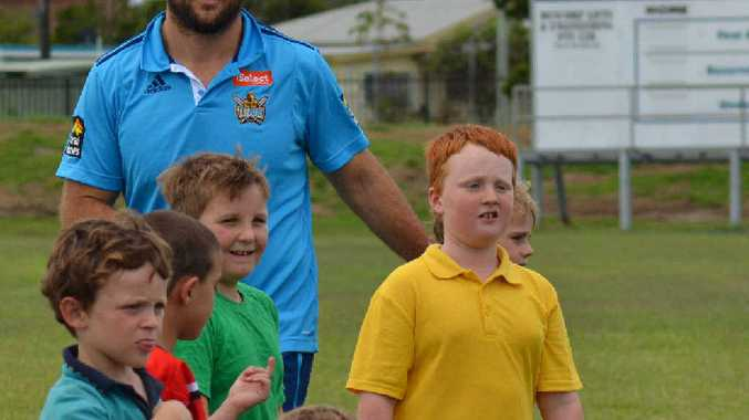 RAW TALENT: Gold Coast Titans co-captain Nate Myles trains with some of the Evans Head boys at Stan Payne Oval.